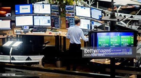 A man stands on the floor of the Euronext stock exchange